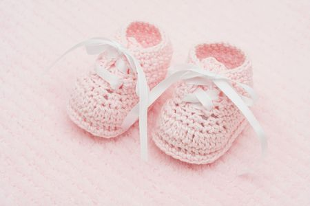 Baby booties on a pink background, baby booties Reklamní fotografie