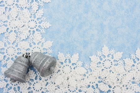 silver bells: Snowflakes making a border with silver bells on a blue background, snowflake border