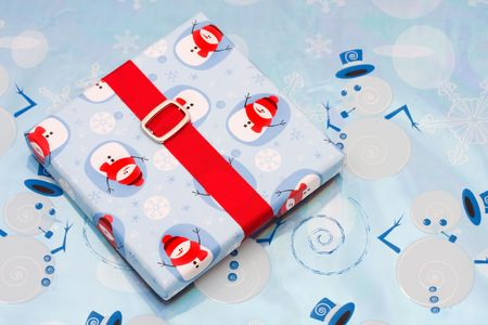 A present sitting on a winter background, christmas present photo
