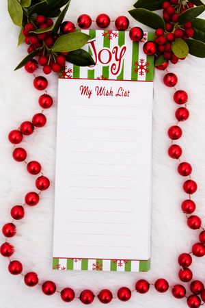 A blank notepad with the word joy on a white fur background photo