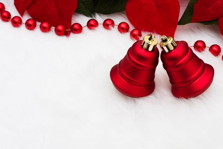 A set of red bells with poinsettia flowers on a white background