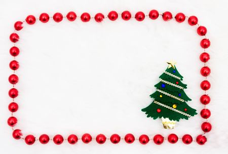 A christmas tree with a beaded border on a white background photo