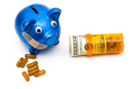 Piggy bank with a bandage over it on a white background, medication costs photo