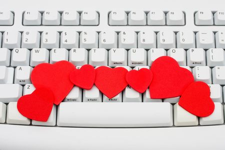 Red hearts sitting on a computer keyboard, internet dating Stock Photo - 6278691