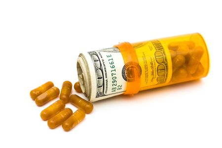 pill bottle: A pill bottle with money on a white background, medication costs