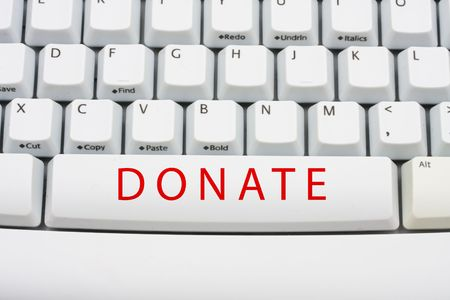 The word donate in red on a computer keyboard, Online donation Stock Photo - 6303740