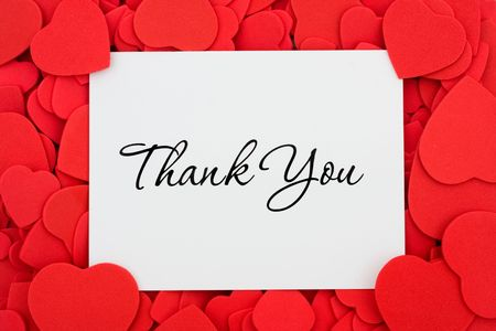 thank you card: A thank you card on a red heart background, thank you Stock Photo