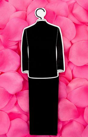 A tuxedo on a flower petal background, wedding dress Imagens