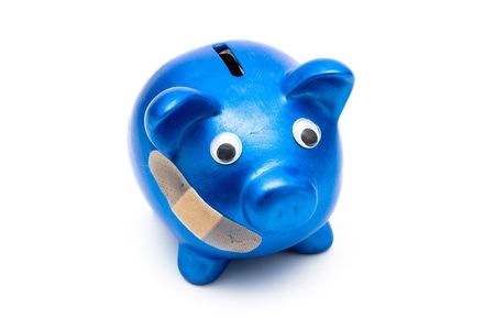 premiums: Piggy bank with a bandage over it on a white background, health care costs Stock Photo