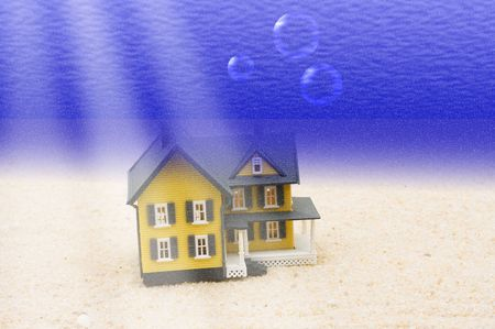 A house underwater sitting in the sand, house underwater photo