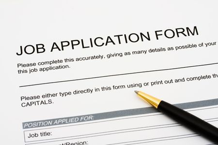 A job application jobs sitting with a pen, applying for a job Stock Photo