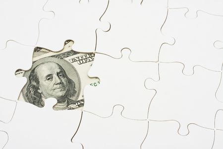 White puzzle on one hundred dollar bill, solving money problems