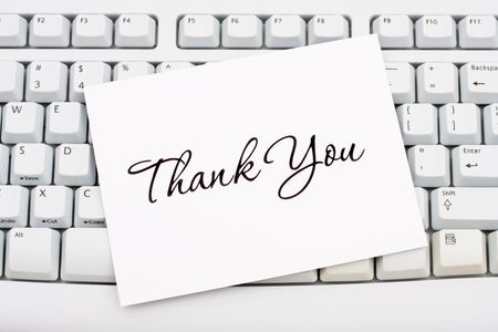 thank you card: A thank you card sitting on a computer keyboard, online thank you
