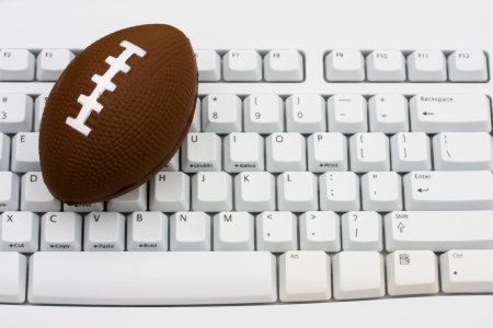 betting: A football sitting on a computer keyboard, Playing fantasy football