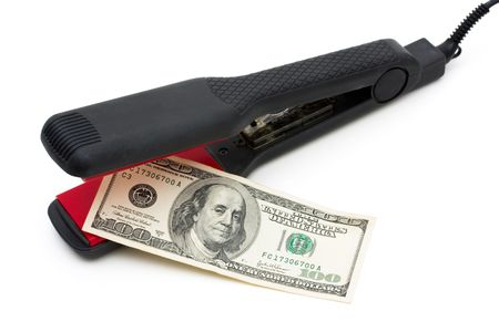 overwhite: A flatiron with a one hundred dollar bill isolated on a white background, hairstyling costs Stock Photo