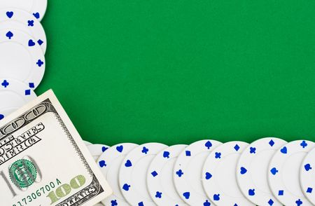 Poker chips making a border on a green background, poker chip border