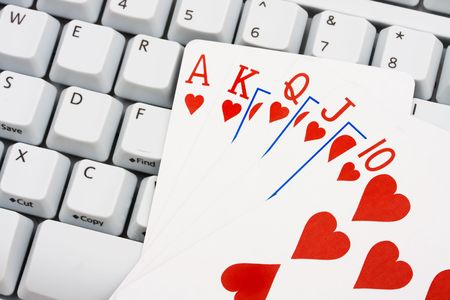 straight flush: A straight flush sitting on a computer keyboard, Playing poker online