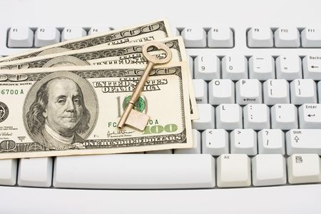 One hundred dollar bills sitting on a computer keyboard, Making Secure Online Purchases Stock Photo