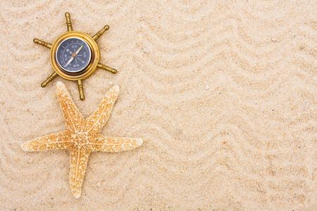 A compass sitting on a sand background, Finding your travel destination Stockfoto