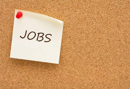 job posting: A yellow sticky note on a corkboard, Job posting Stock Photo