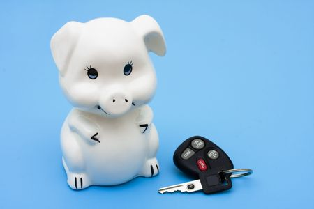 purchase: A piggy bank with a set of car keys on a blue background, Financing your car
