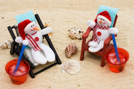 A lounge chair with snowmen on a sand background, Relaxing on your winter vacation  photo