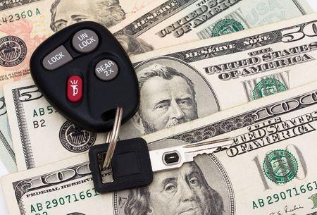 50 dollar bill: A set of car keys with cash, car payment Stock Photo