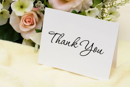 thank you card: A bouquet of flowers with a thank you card, thank you card
