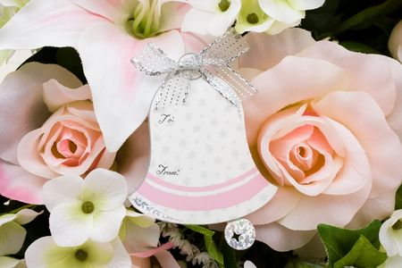bell shaped: A bouquet of flowers with a bell shaped gift tag, Wedding gift tag