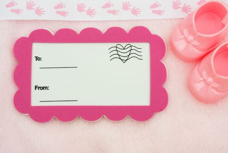 A postcard with a baby booties on a pink background with a foot and hand print border, baby shower gift Stock Photo - 6679182