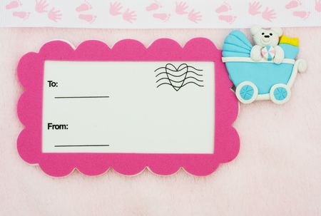 A postcard with a baby stroller on a pink background with a foot and hand print border, baby shower gift Stock Photo - 6771505