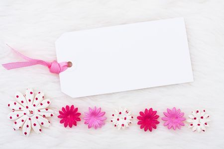 A pink flowers making a border on a white background, pink flower border