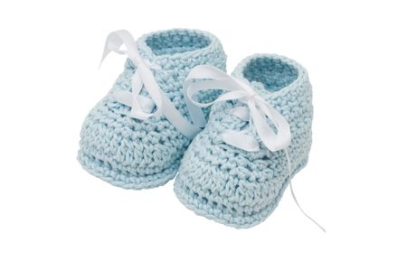 Baby booties on a white background, blue boy baby booties Reklamní fotografie
