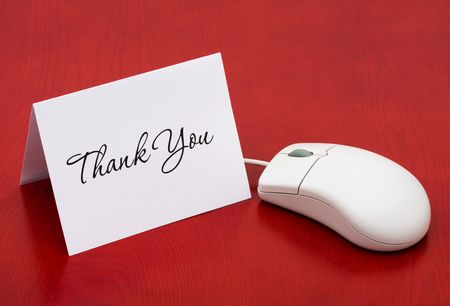 mouse: A computer mouse with a thank you card on a red background, Thank You for your online purchase