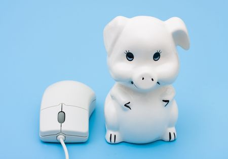 internet banking: A computer mouse with a piggy bank on a blue background, internet banking Stock Photo