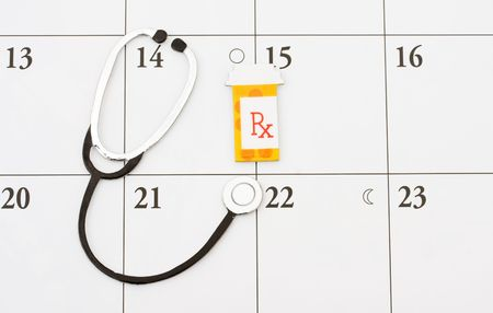 A pill bottle and a stethoscope on a calendar background, doctor appointment