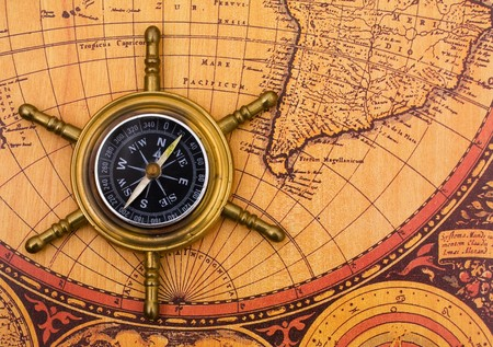 A compass on a old world map background