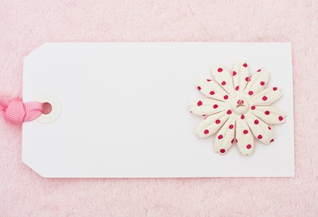 A pink flowers on a blank tag on a pink background, pink flower Tag