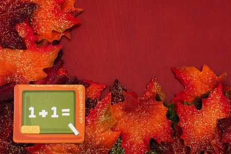 Fall leaves with a chalkboard on a brown background, back to school Stock Photo - 6894635