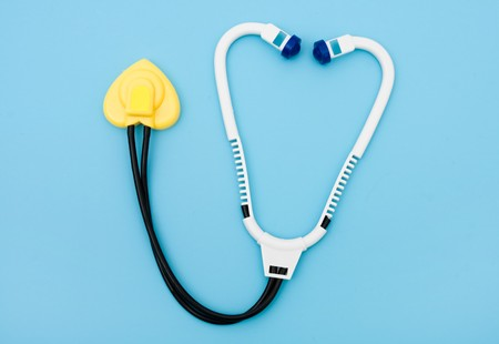 A toy stethoscope on a blue background, healthcare Stock Photo - 6931687