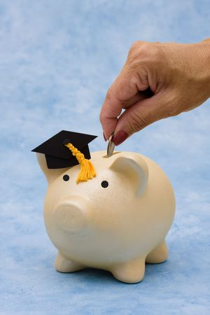 Piggy bank with graduation cap on a blue background, education savings photo