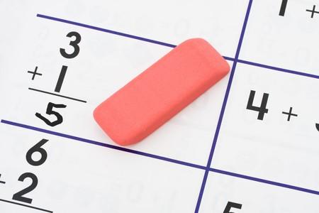 An eraser on a math sheet background, math homework Stock Photo