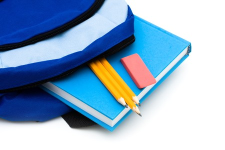 A backpack with pencils and an eraser and book isolated on a white background, school work