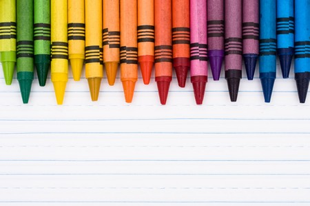 school border: Colorful crayons on a sheet of lined paper, Education background