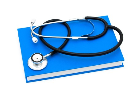 A stethoscope on a  book isolated on a white background, Learning about your health