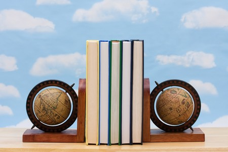 A stack of book between book end with a sky background, International education Stock Photo