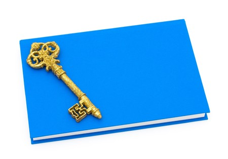 Blue book with a golden key isolated on white, Education is the key to success Stock Photo