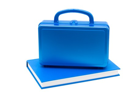 Blue lunch box with a blue book isolated on white, School Lunches Stock Photo