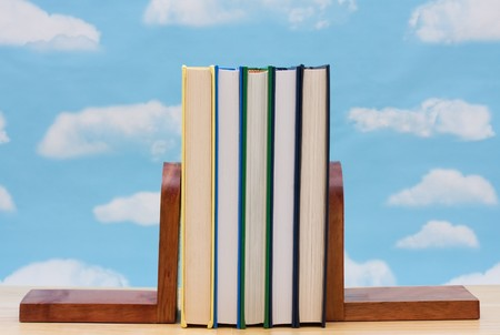 A stack of book between book end with a sky background, Learning