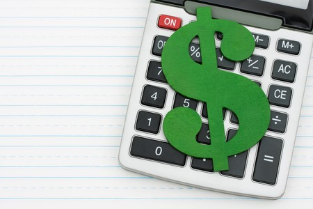 cost estimate: A calculator on a notepad with a dollar sign, Cost of education  Stock Photo